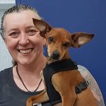 Volunteer Jules helping out with cuddles for Titch